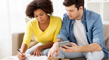 young couple reviewing financials
